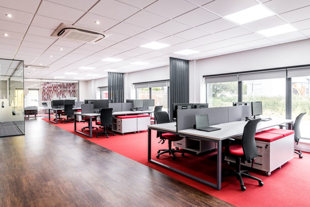 APS showroom open plan office area with bench desks, suspended ceilings and flooring finishes.