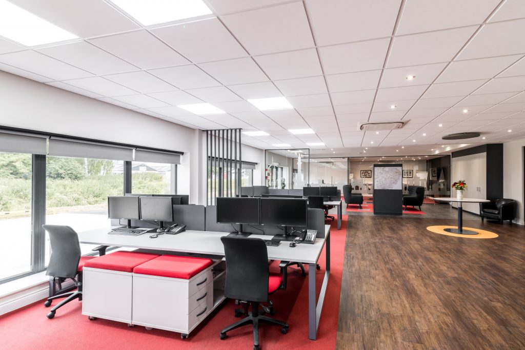 Open plan office space planning with feature flooring design.